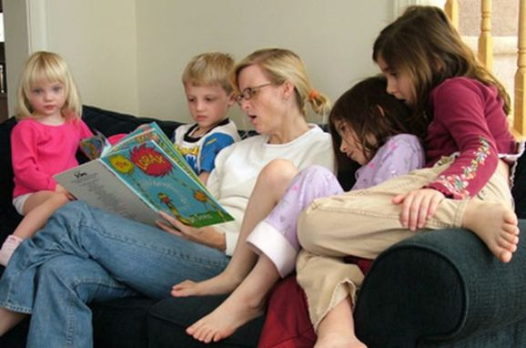 mother-reading-to-kids_royaltyfree