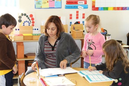 teacher-working-with-3-children