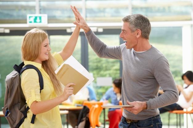 Teacher Congratulating Pupil On Successful Exam Result