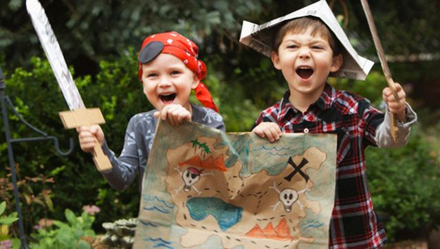 West New York, New Jersey, USA --- Caucasian boys dressed as pirates --- Image by © KidStock/Blend Images/Corbis
