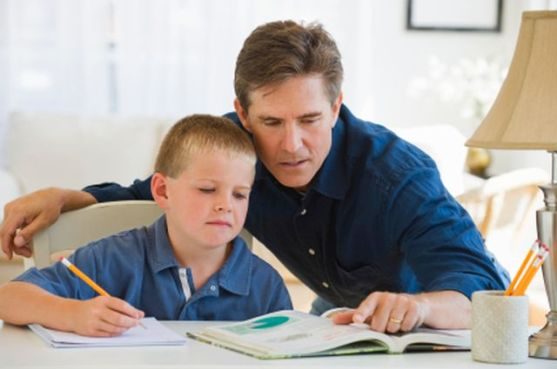 Father helping his son with homework