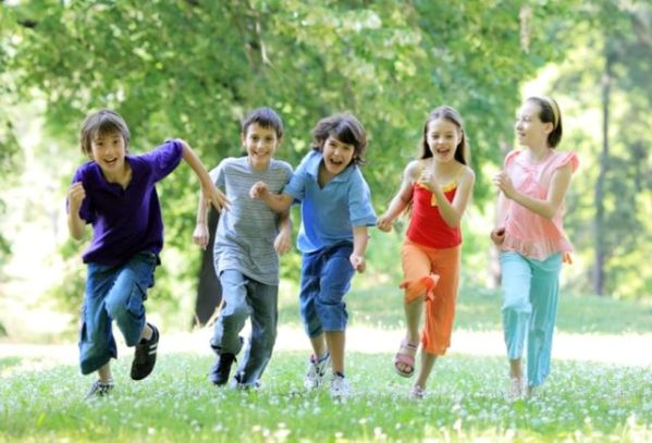 Children running in the green park.