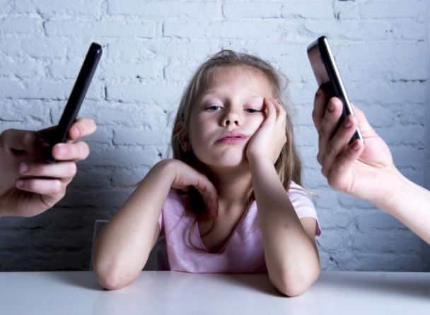 addict mobile phone parents neglecting daughter ignored and bored