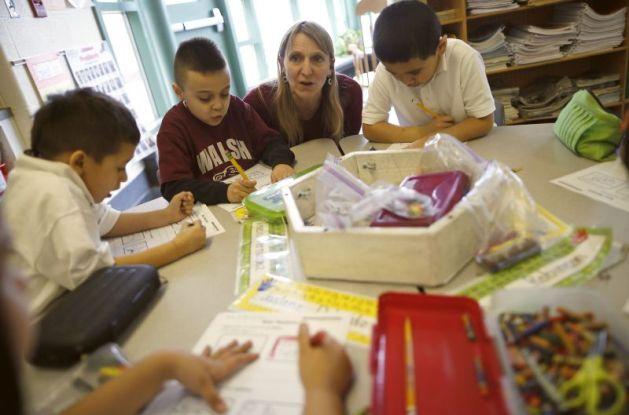 Teacher Audrey Benes speaks to her kindergarten class at Walsh Elementary School in Chicago, Illinois