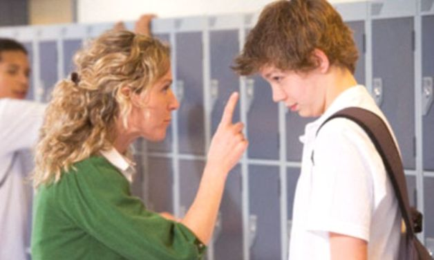 Female teacher reprimanding a male student